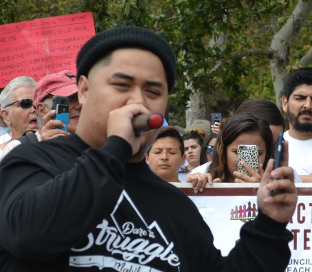 Jedi Jimenez speaks, Saturday, June 30, to pro-immigration protesters in Caesar Chavez Park, Long Beach; photo by Barry Saks